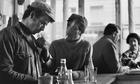 men smoking in cafe