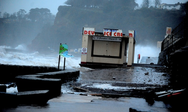 Waves thrash the coast by a section of the Dawlish sea wall in Devon which has been destroyed by gale force winds high seas.