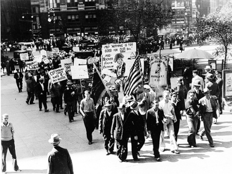 Hundreds of Communists and radical sympathizers march with placards to meet New York City Mayor Joseph V. McKee at City Hall to present demands for unemployment relief, Sept. 10, 1932 during the Great Depression.  (AP Photo)