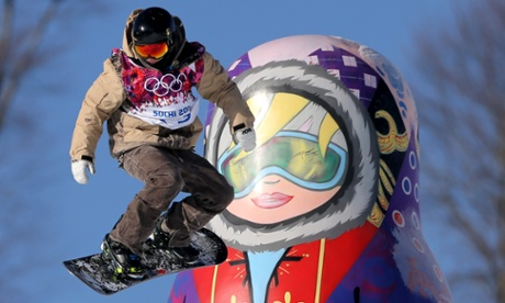 A competitor makes a jump during snowboard Slopestyle training at the Rosa Khutor Extreme Park during the 2014 Sochi Olympic Games in Krasnaya Polyana, Russia.