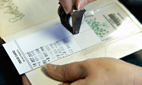 Check it out … stamping a library book. Photograph: Geraint Lewis /Alamy