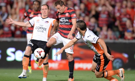Brendon Santalab is challegned by the Roar's Matthew Smith and Jade North.