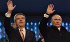 Russia's President Vladimir Putin waves