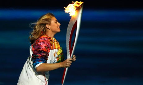 Russian tennis player Maria Sharapova carries the Olympic torch during the opening ceremony of the 2014 Winter Olympics.
