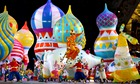 Dancers perform against a backdrop of onion domes during the opening of the Sochi Winter Olympics