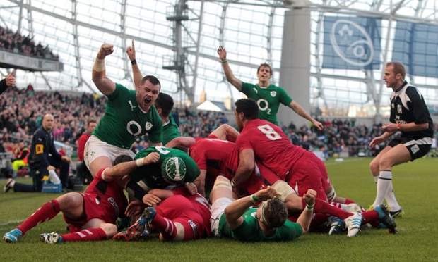 Ireland's Chris Henry scores a try against Wales.