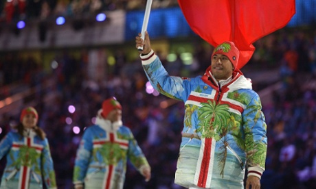 Tonga's flag bearer, Bruno Banani, leads his national delegation during the Opening Ceremony of the Sochi Winter Olympics.