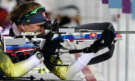 Slovakia's Anastasiya Kuzmina shoots during the women's biathlon 7.5k sprint, at the 2014 Winter Olympics.