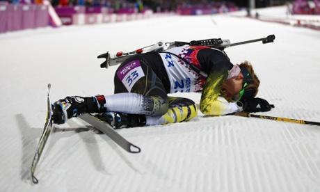 Slovakia's Anastasiya Kuzmina reacts after crossing the finish line after women's biathlon 7.5km sprint event at the Sochi 2014 Winter Olympics.