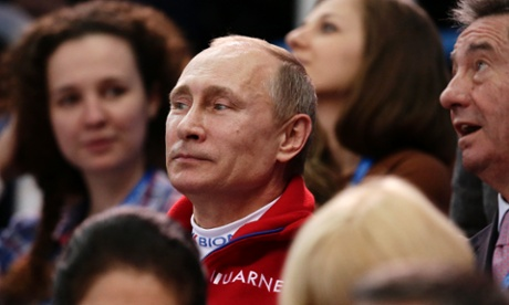 Russian President Vladimir Putin attends the figure skating competition at the 2014 Winter Olympics,.