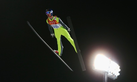 Andreas Wank of Germany jumps during the men's normal hill individual first round at the 2014 Sochi Winter Olympics.