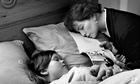 Woman asleep reading to child