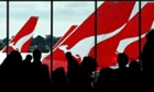 Passengers wait inside the terminal to board their Qantas flight.