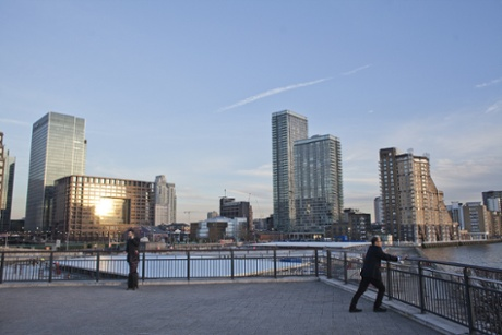 Employees enjoy a warm evening sun in Canary Wharf as the temperature rises.