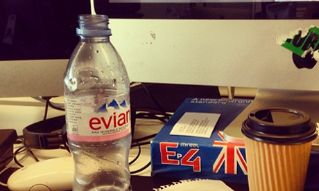 Evian bottle on desk