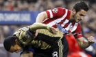 Atlético Madrid's Koke, right, fights for the ball with Milan's Urby Emanuelson.
