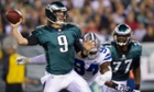 Philadelphia Eagles quarterback Nick Foles looks to throw as Dallas's DeMarcus Ware closes in