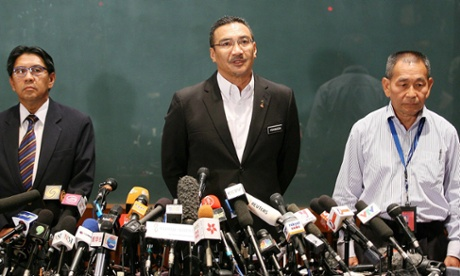 Malaysia's Minister of Defence and acting Transport Minister Datuk Seri Hishammuddin Hussein (centre) with Department of Civil Aviation director general Azharuddin Abdul Rahman (left) and Malaysian Airlines Group Chief Executive Ahmad Jauhari Yahyain (right) speak about the missing Malaysian Airlines plane during a press conference.
