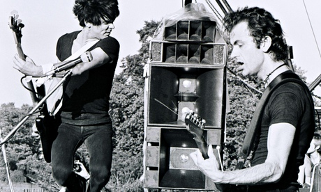 The Stranglers' Jean-Jacques Burnel and Hugh Cornwell playing in Battersea Park in London in 1978. Photograph: Gus Stewart/Redferns