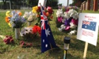 Tributes to Chris Lane, 22, on the site where he was killed in Oklahoma