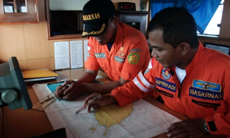 Members of a Search and Rescue ship look at a map of the Straits of Malacca as they hunt for the missing Malaysia Airlines flight. Malaysia's military has traced what could have been the missing Boeing near India's Andaman and Nicobar islands