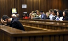 Oscar Pistorius reacts in the dock during his trial for the murder of girlfriend Reeva Steenkamp