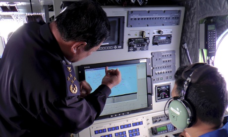 Malaysian Maritime Enforcement Agency, Director General of the Malaysian Maritime Enforcement Agency Admiral Mohd Amdan Kurish, left, checks a radar during a searching for the missing Malaysia Airlines plane.