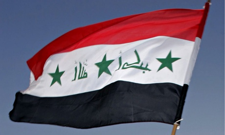 An Iraqi flag flying against blue sky