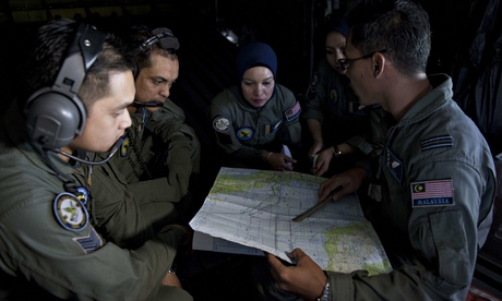 A Royal Malaysian air force team search for the missing Malaysia Airlines flight MH370