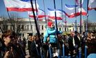 Pro-Russian supporters rally in Lenin Square in Simferopol, Ukraine on the eve of a referendum on wh