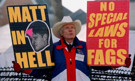 Pastor Fred Phelps Sr displays provocative placards in Laramie, Wyoming in April 1999. Photograph: David Zabulowski/AP