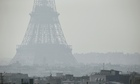 The Eiffel tower seen through thick smog, in Paris.