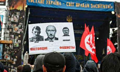 Poster in Kiev with a photo of Hitler alongside ones of Putin and Yanukovych with Hitler moustaches