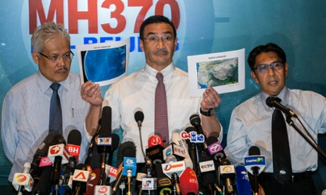 Malaysian acting transport minister Hishamuddin Hussein shows north corridor and south corridor maps with deputy minister of foreign affairs, Hamzah Zainudin and Malaysia's department civil aviation director general, Azharuddin Abdul Rahman during a media conference at Kuala Lumpur International Airport.
