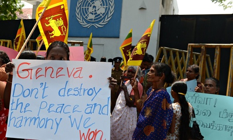 Tamil pro-government activist hold a placard outside the UN offices in Colombo