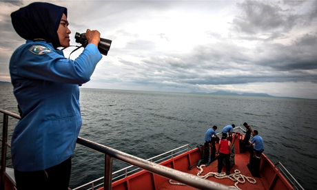 A member of Indonesia's Search and Rescue scans the horizon of the Andaman Sea for flight MH370