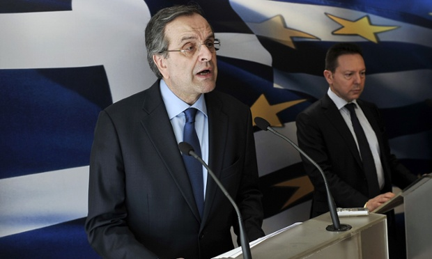 Greek Prime minister Antonis Samaras (L) and Finance minister Yiannis Stournaras address the press at the Greek Finance ministry in Athens on March 18, 2014, after Greece's international creditors have reached agreement with Athens on efforts to stabilise the crisis-hit country's public finances, clearing the