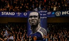 Chelsea fans hold a banner welcoming back Didier Drogba.