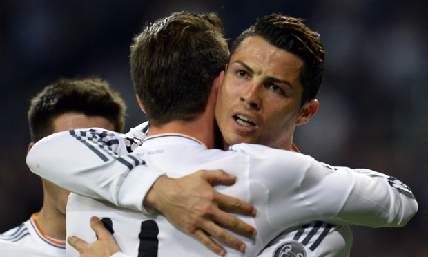 Real Madrid's Cristiano Ronaldo is congratulated by Gareth Bale after scoring against Schalke.