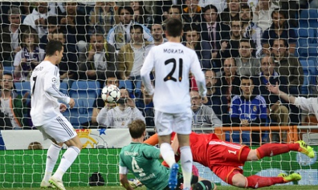 Real Madrid's Cristiano Ronaldo scores against Schalke in the Champions League second leg