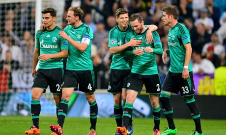 Schalke's Tim Hoogland, second from right, is congratulated by his team-mates after scoring against Real Madrid.
