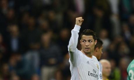 Cristiano Ronaldo celebrates after scoring Real Madrid's second goal against Schalke.