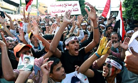 Yemenis shout slogans during a rally in the capital, Sanaa, on 18 September 2013. Photograph: Mohammed Huwais/AFP/Getty Images
