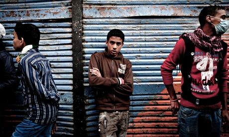 Egyptian youths in Cairo during the unrest in November 2011. Photograph: Kim Badawi Images/Getty Images