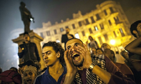 Young protesters shout slogans against the new government in November 2013. Photograph: Mahmoud Khaled/Rex Features
