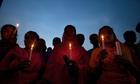 Bangladeshi garment workers and victims' relatives hold a candlelit memorial at the Rana Plaza site