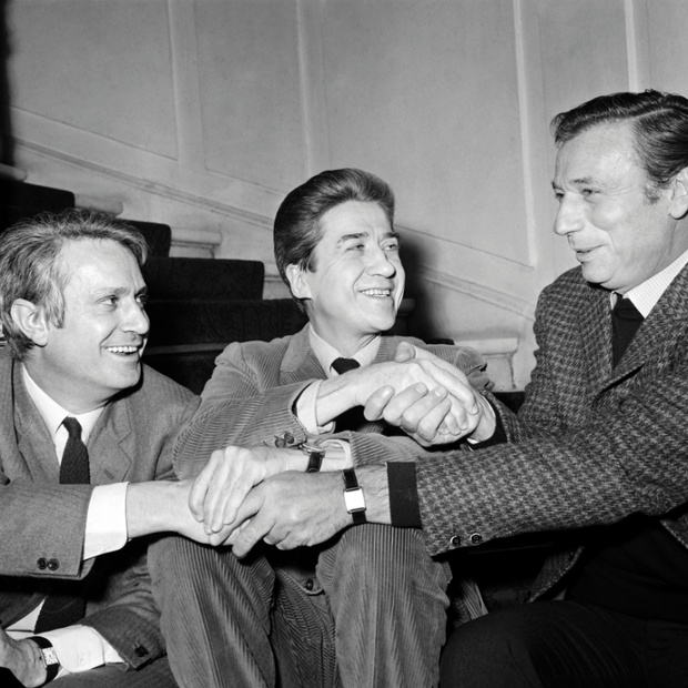 1967: French film director Alain Resnais (C) speaks with french actor Yves Montand (R) and writer Jorge Semprun (L) after receiving the Louis Delluc award for his movie