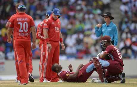 Dwayne Bravo of the West Indies lies on the ground after been hit on the neck by a ball from England captain Stuart Broad.