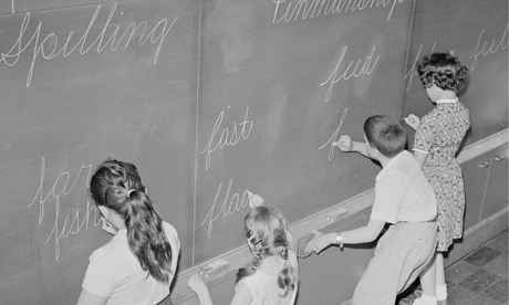 Schoolchildren Writing on Blackboard