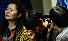 Chinese relatives of passengers from missing Malaysia Airlines flight MH370 wait for news in Beijing